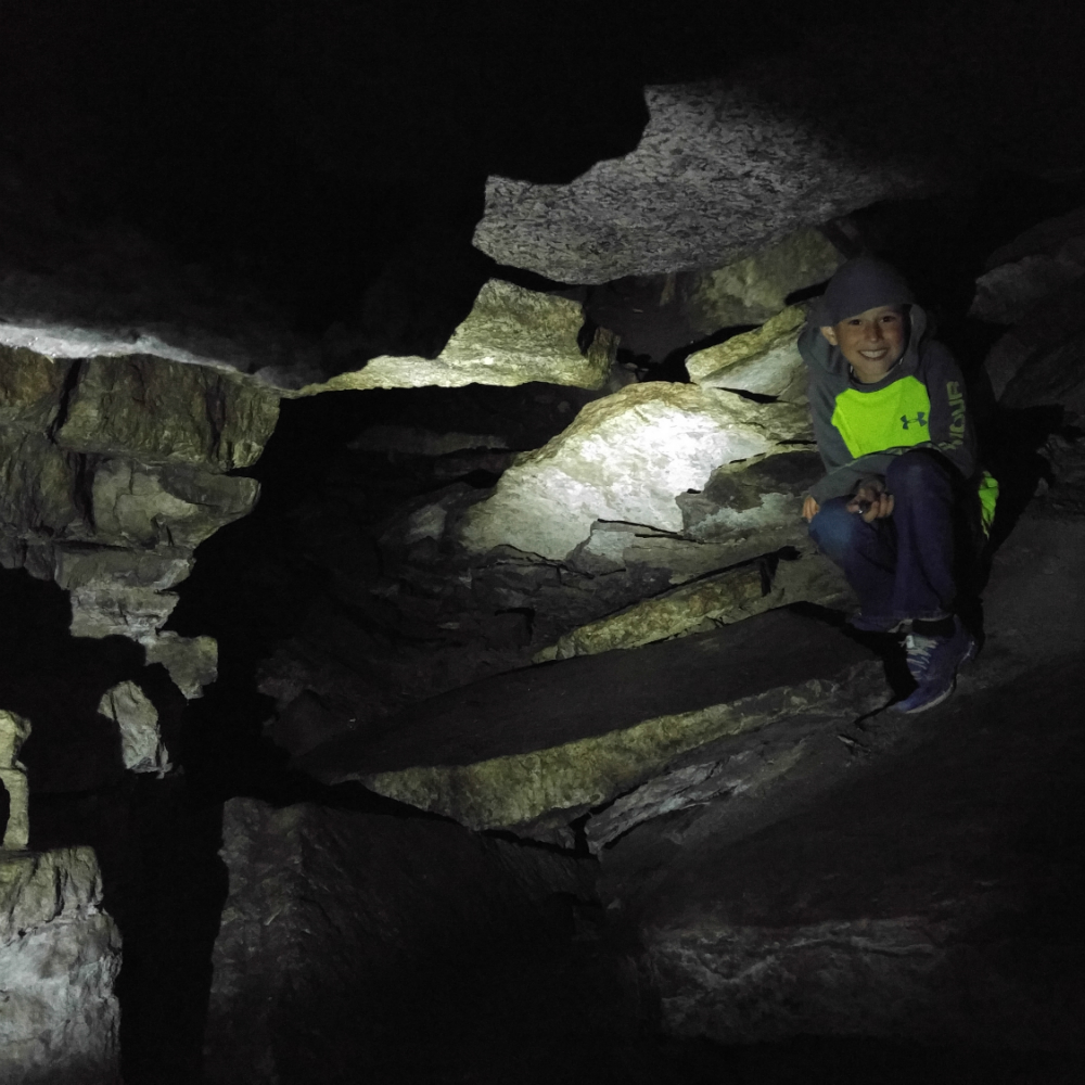 The Hell Hole is a 2.5 x 3.5 metre cavern - and pitch black. Bring a head lamp for spleunking!