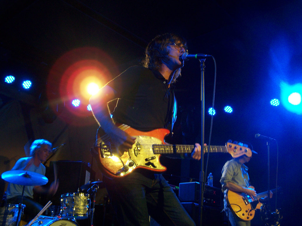 The band Sloan onstage with singer at the microphone.