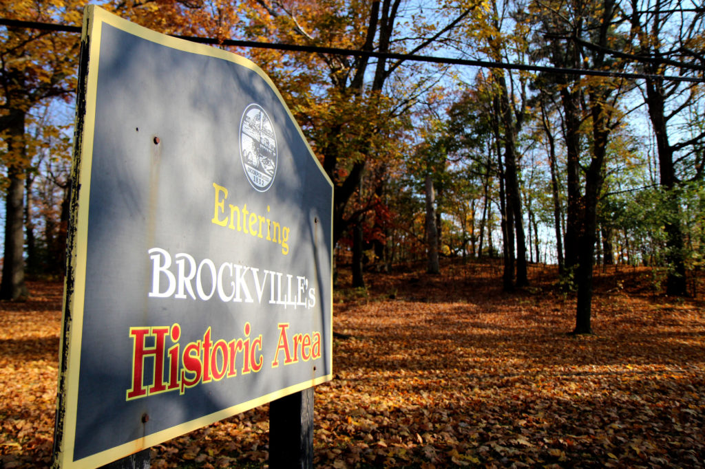 "The Brock Trail in the Fall with a sign stating, ""Entering Brockville's Historic Area."""