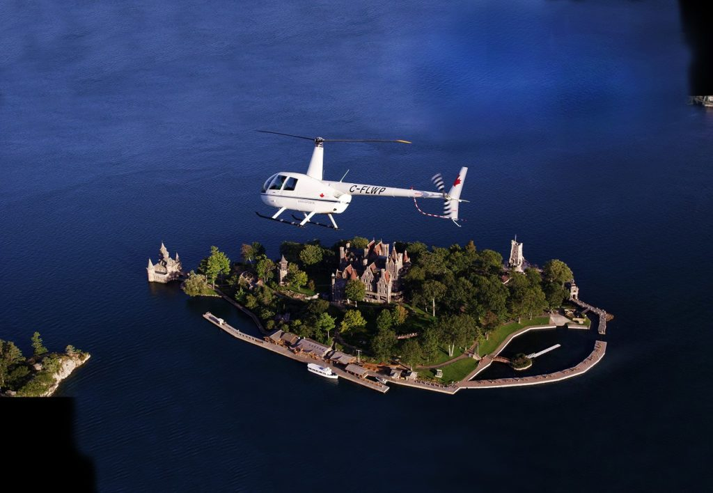 A 1000 Islands Helicopter Tour chopper high above Boldt Castle.