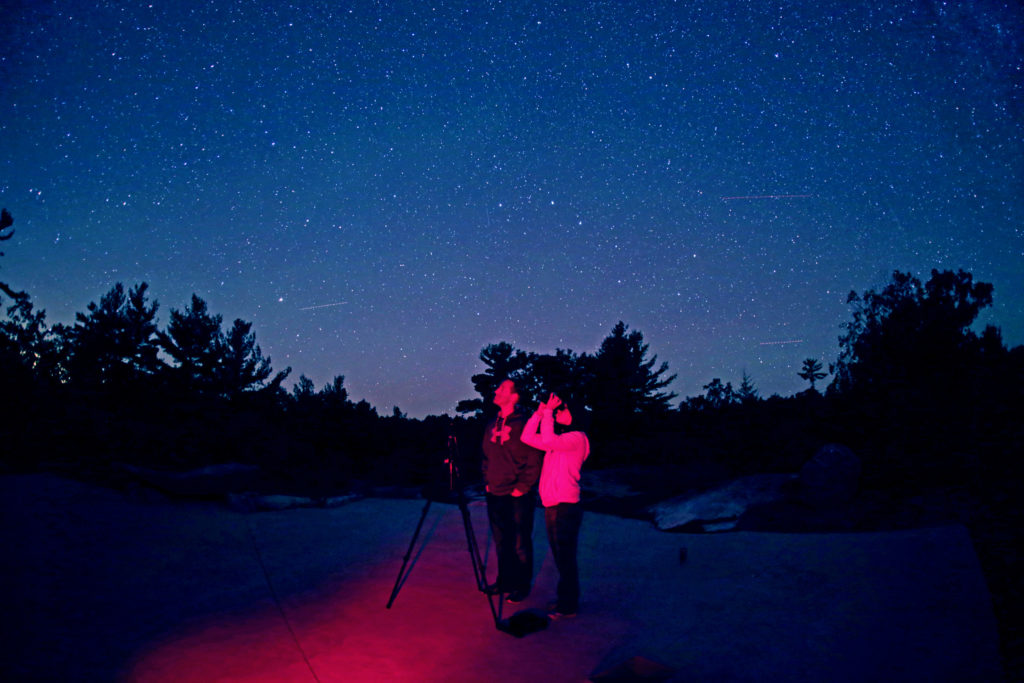 A couple looking up at the starry sky at The Dark Sky Viewing Area.