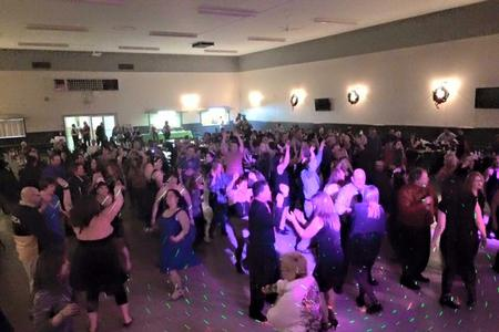 CAPE New Year's Eve 2015 photo, with hundreds of people dancing inside a large room.