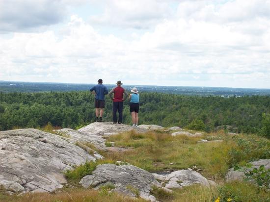 3 people enjoying the view from Blue Mountain, Charleston Lake