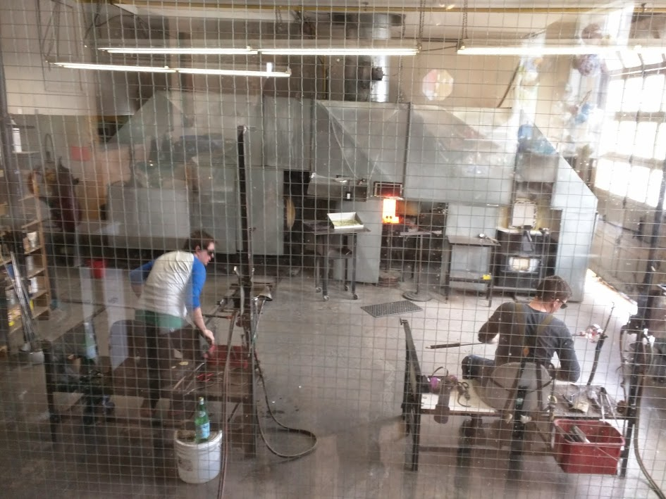 Glass blowers at work.