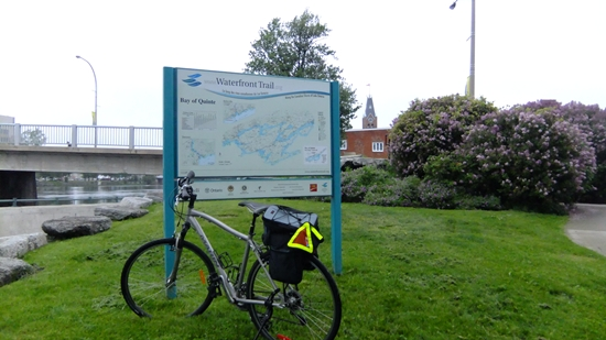 Bicycle parked next to Waterfront Trail sign along the Moira River, downtown Belleville