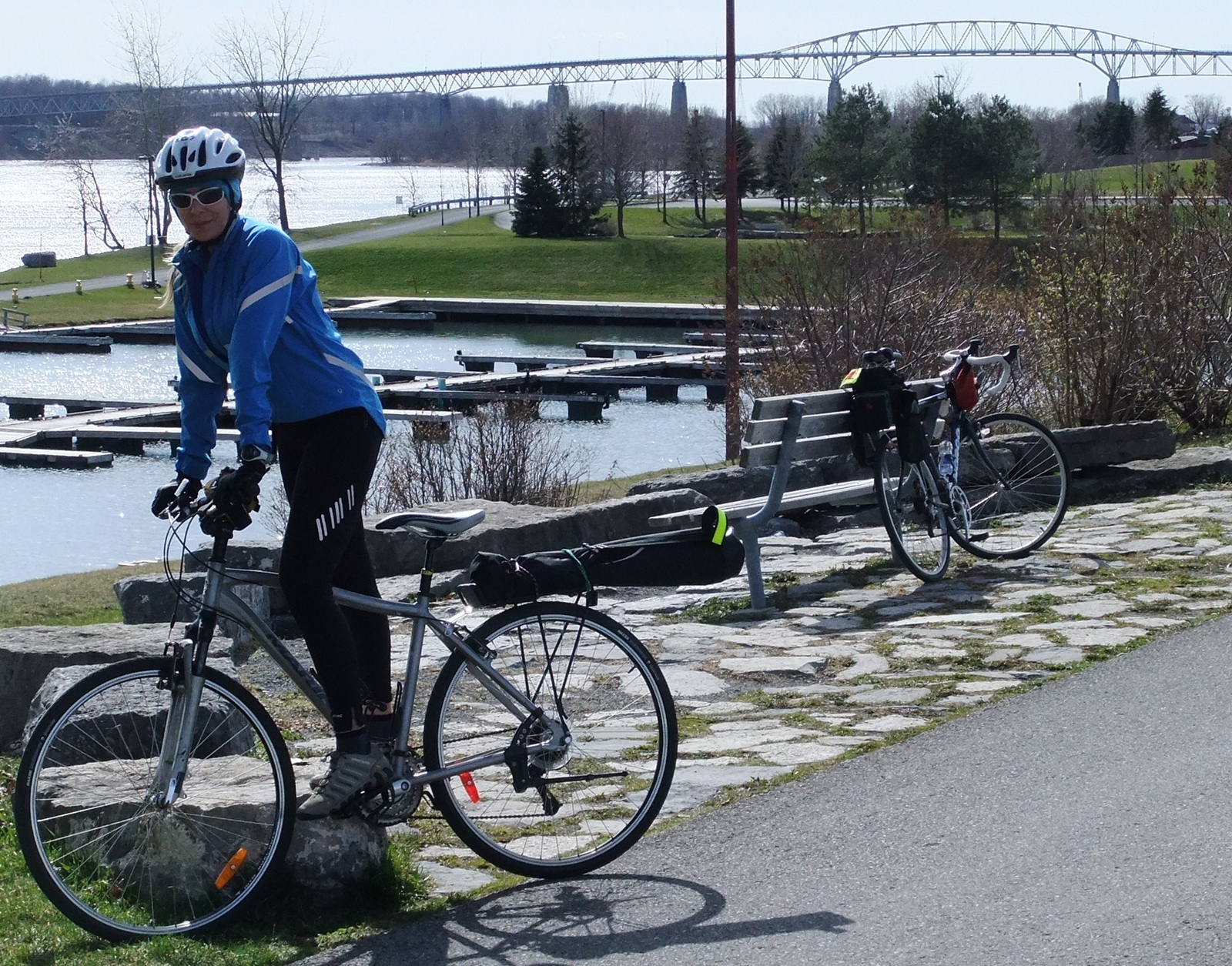 BaffinPaddler cycling Waterfront Trail in Cornwall, International Bridge in background