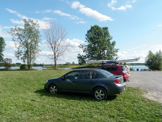 Cars parked waterfont at free parking at Ingleside, Ontario on the St. Lawrence River