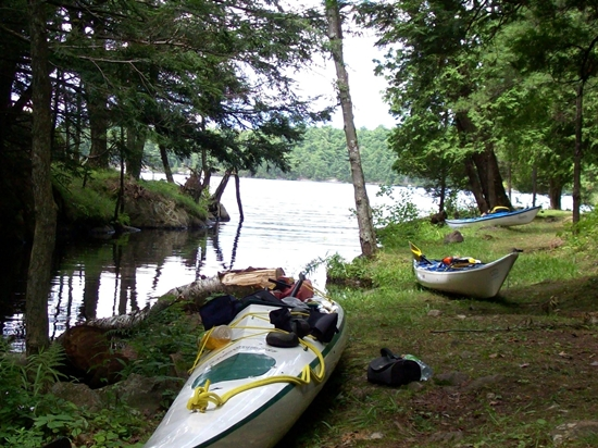 Kayaks parked on shoreline, Huckleberry Hollow, Charleston Lake