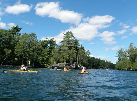 Kayakers paddling toward Tar Island