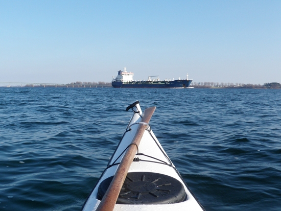 Kayak and shipping tanker on the St. Lawrence