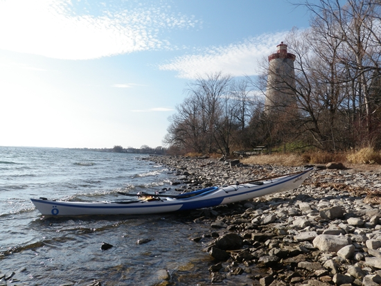 Sea kayak landed on rocky shore of the Battle of the Windmill historic site