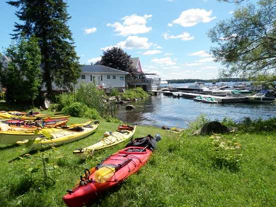 Kayaks parked on grass next to Boathouse Restaurant