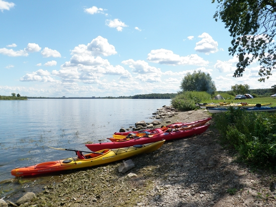 Sea kayaks beached on the shore of McDonald Island, Long Sault Parkway, Ontario