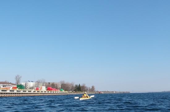 Sea kayak passing by Prescott Coast Guard Base on St. Lawrence