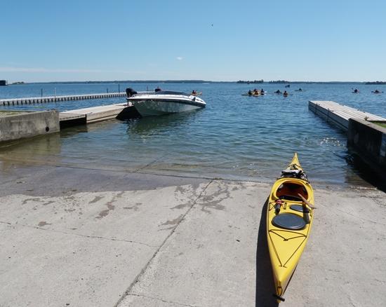 Kayak and motor boat at boat launch