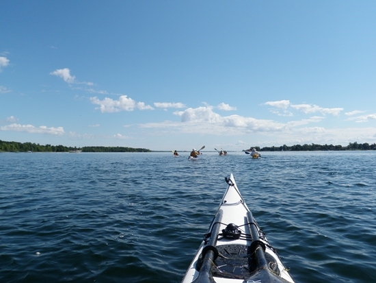 Group of kayakers paddling on the St. Lawrence River along the Long Sault Parkway